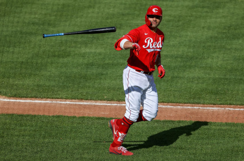 CINCINNATI, OHIO - MAY 01: Joey Votto #19 of the Cincinnati Reds tosses his bat after drawing a walk in the third inning against the Chicago Cubs at Great American Ball Park on May 01, 2021 in Cincinnati, Ohio. (Photo by Dylan Buell/Getty Images)