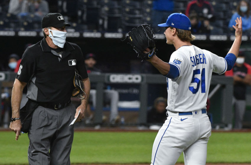 Kansas City Royals pitcher Brady Singer loses mind on Angel Hernandez (Photo by Ed Zurga/Getty Images)