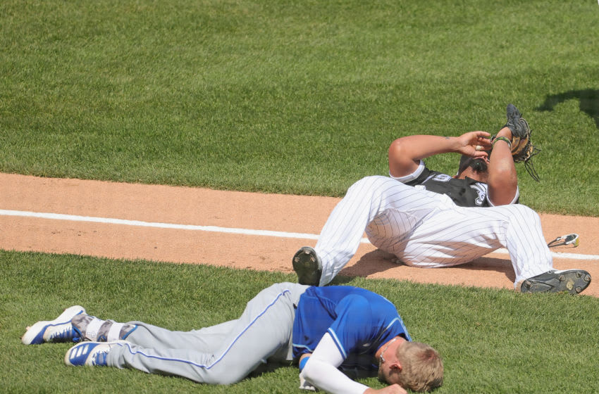 Jose Abreu collides with Hunter Dozier in White Sox-Royals (Photo by Jonathan Daniel/Getty Images)