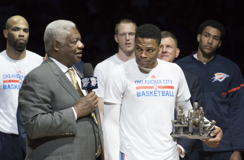 Oscar Robertson and Russell Westbrook. (Photo by J Pat Carter/Getty Images)