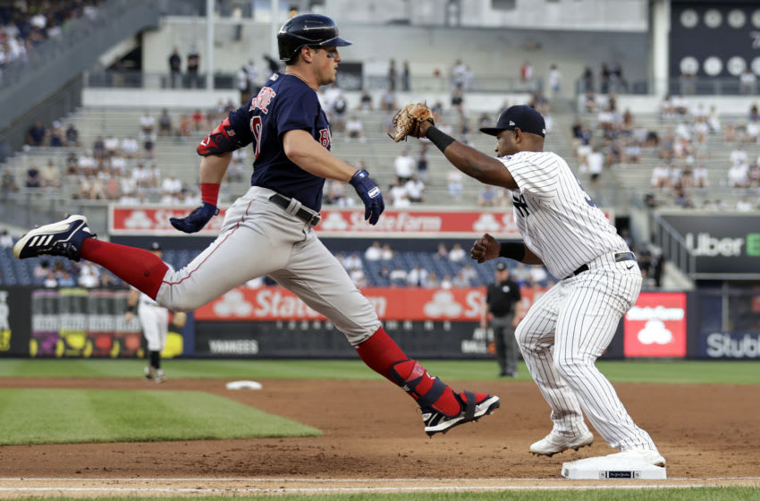 NEW YORK, NY - JUNE 6: Hunter Renfroe #10 of the Boston Red Sox is forced out at first base as Chris Gittens #92 of the New York Yankees makes the catch during the second inning at Yankee Stadium on June 6, 2021 in the Bronx borough of New York City. (Photo by Adam Hunger/Getty Images)