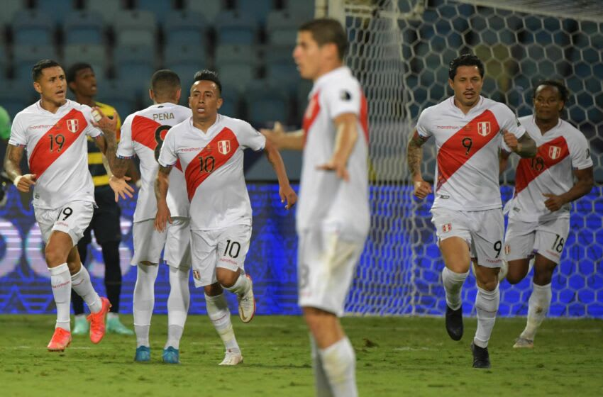 Peru's Gianluca Lapadula (2nd R) celebrates after scoring against Ecuador during their Conmebol Copa America 2021 football tournament group phase match at the Olympic Stadium in Goiania, Brazil, on June 23, 2021. (Photo by NELSON ALMEIDA / AFP) (Photo by NELSON ALMEIDA/AFP via Getty Images)