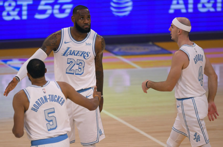 LOS ANGELES, CA - DECEMBER 25: Talen Horton-Tucker #5, LeBron James #23 and Alex Caruso #4 of the Los Angeles Lakers while playing the Dallas Mavericks at Staples Center on December 25, 2020 in Los Angeles, California. (Photo by John McCoy/Getty Images)