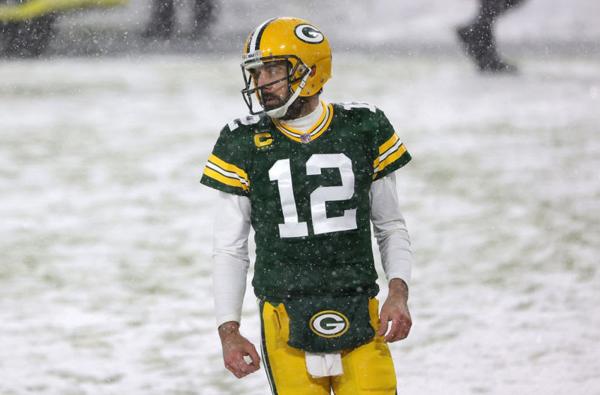 GREEN BAY, WISCONSIN - DECEMBER 27: Aaron Rodgers #12 of the Green Bay Packers participates in warmups prior to a game against the Tennessee Titans at Lambeau Field on December 27, 2020 in Green Bay, Wisconsin. (Photo by Stacy Revere/Getty Images)
