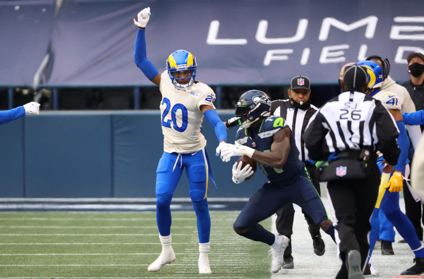 SEATTLE, WASHINGTON - JANUARY 09: Jalen Ramsey #20 of the Los Angeles Rams celebrates his tackle against DK Metcalf #14 of the Seattle Seahawks in the second quarter during the NFC Wild Card Playoff game at Lumen Field on January 09, 2021 in Seattle, Washington. (Photo by Abbie Parr/Getty Images)