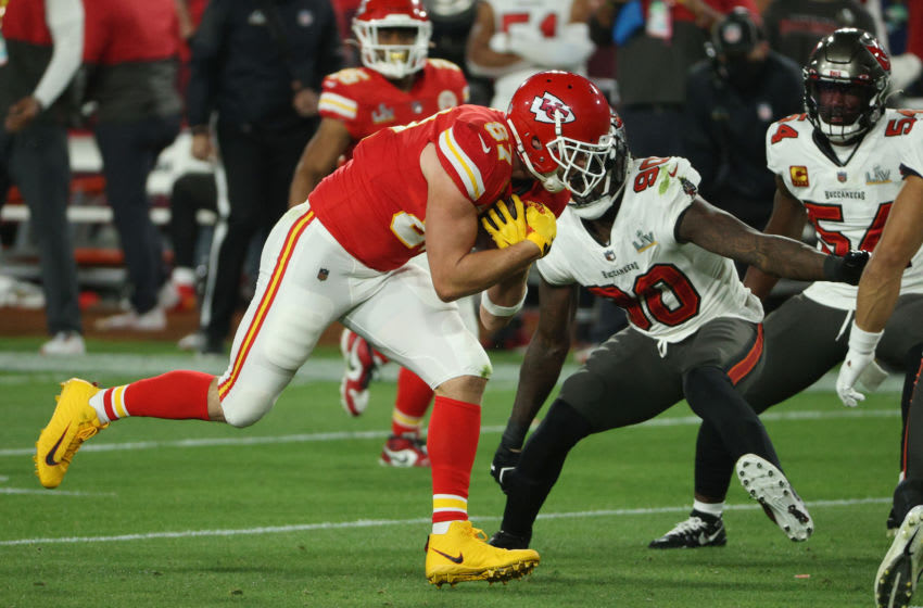 TAMPA, FLORIDA - FEBRUARY 07: Travis Kelce #87 of the Kansas City Chiefs rushes ahead of Jason Pierre-Paul #90 of the Tampa Bay Buccaneers in Super Bowl LV at Raymond James Stadium on February 07, 2021 in Tampa, Florida. (Photo by Patrick Smith/Getty Images)