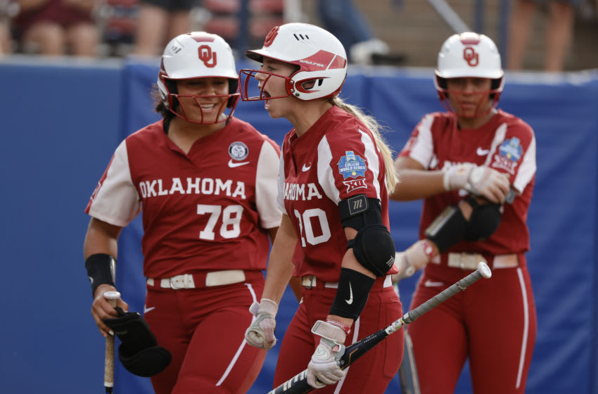 OKLAHOMA CITY, OKLAHOMA - JUNE 09: Jana Johns #20 of the Oklahoma Sooners reacts after hitting a home run during the third inning of Game 2 of the Women's College World Series Championship against the Florida St. Seminoles at USA Softball Hall of Fame Stadium on June 09, 2021 in Oklahoma City, Oklahoma. (Photo by Sarah Stier/Getty Images)