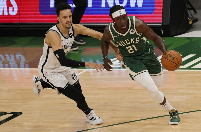MILWAUKEE, WISCONSIN - JUNE 10: Jrue Holiday #21 of the Milwaukee Bucks drives around Landry Shamet #20 of the Brooklyn Nets during the first half of Game Three of the Eastern Conference second round playoff series at the Fiserv Forum on June 10, 2021 in Milwaukee, Wisconsin. NOTE TO USER: User expressly acknowledges and agrees that, by downloading and or using this photograph, User is consenting to the terms and conditions of the Getty Images License Agreement. (Photo by Stacy Revere/Getty Images)
