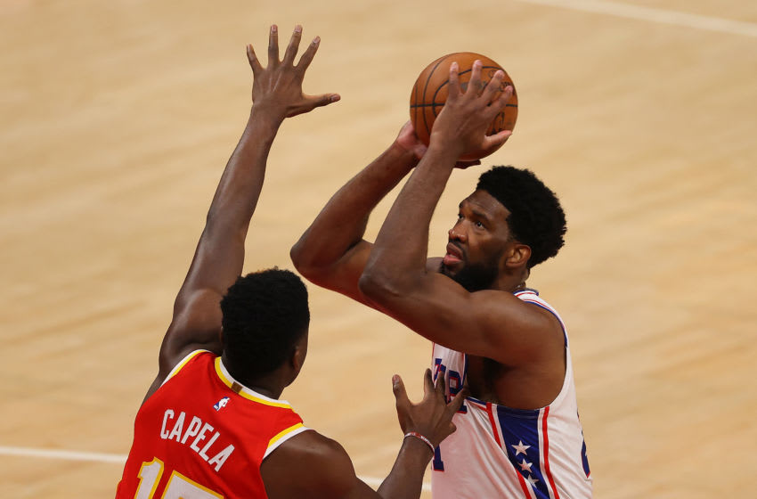 ATLANTA, GEORGIA - JUNE 11: Joel Embiid #21 of the Philadelphia 76ers drives against Clint Capela #15 of the Atlanta Hawks during the first half of game 3 of the Eastern Conference Semifinals at State Farm Arena on June 11, 2021 in Atlanta, Georgia. NOTE TO USER: User expressly acknowledges and agrees that, by downloading and or using this photograph, User is consenting to the terms and conditions of the Getty Images License Agreement. (Photo by Kevin C. Cox/Getty Images)