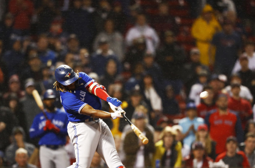 BOSTON, MASSACHUSETTS - JUNE 14: Vladimir Guerrero Jr. #27 of the Toronto Blue Jays hits a solo home run at the top of the ninth inning of the game against the Boston Red Sox at Fenway Park on June 14, 2021 in Boston, Massachusetts. (Photo by Omar Rawlings/Getty Images)