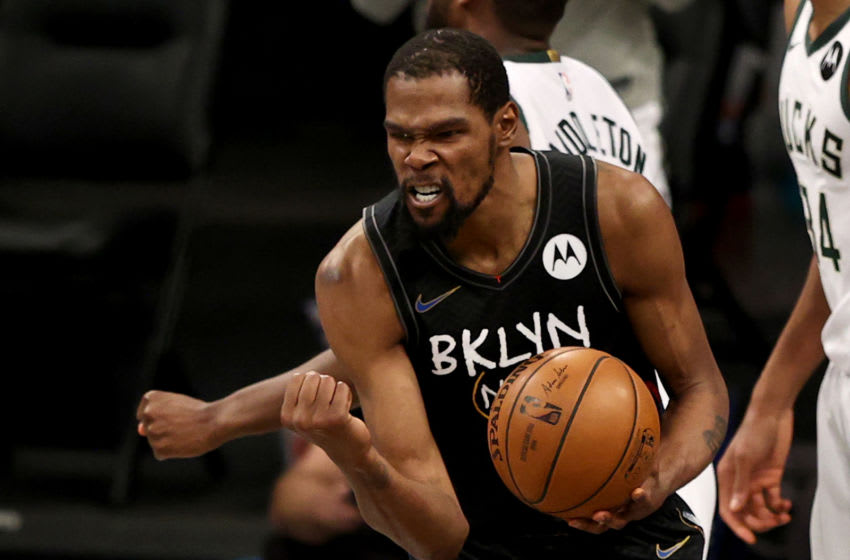 NEW YORK, NEW YORK - JUNE 15: Kevin Durant #7 of the Brooklyn Nets celebrates after he is fouled late in the fourth quarter against the Milwaukee Bucks during game 5 of the Eastern Conference second round at Barclays Center on June 15, 2021 in the Brooklyn borough of New York City. NOTE TO USER: User expressly acknowledges and agrees that, by downloading and or using this photograph, User is consenting to the terms and conditions of the Getty Images License Agreement. (Photo by Elsa/Getty Images)