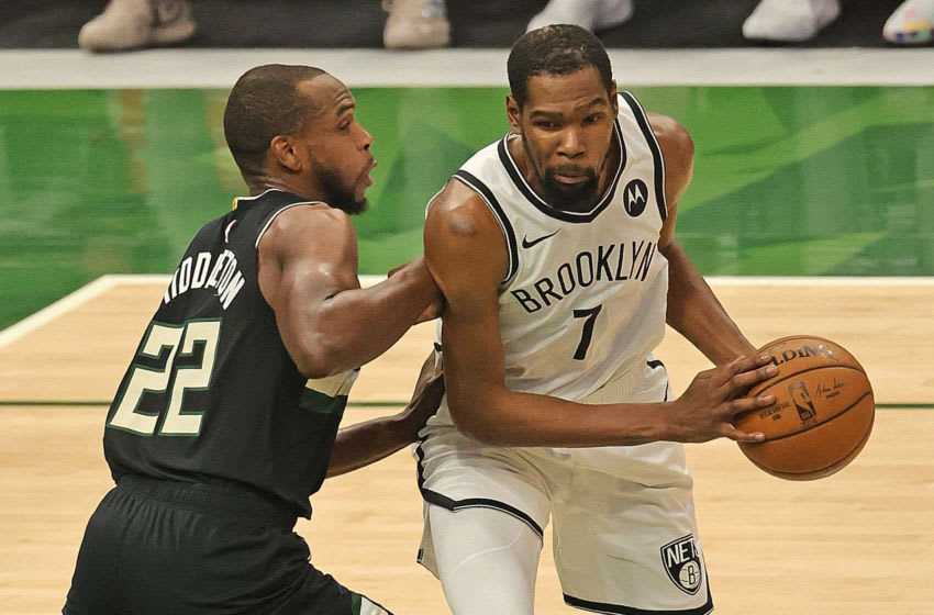 MILWAUKEE, WISCONSIN - JUNE 17: Kevin Durant #7 of the Brooklyn Nets moves against Khris Middleton #22 of the Milwaukee Bucks at Fiserv Forum on June 17, 2021 in Milwaukee, Wisconsin. The Bucks defeated the Nets 104-89. NOTE TO USER: User expressly acknowledges and agrees that, by downloading and or using this photograph, User is consenting to the terms and conditions of the Getty Images License Agreement. (Photo by Jonathan Daniel/Getty Images)