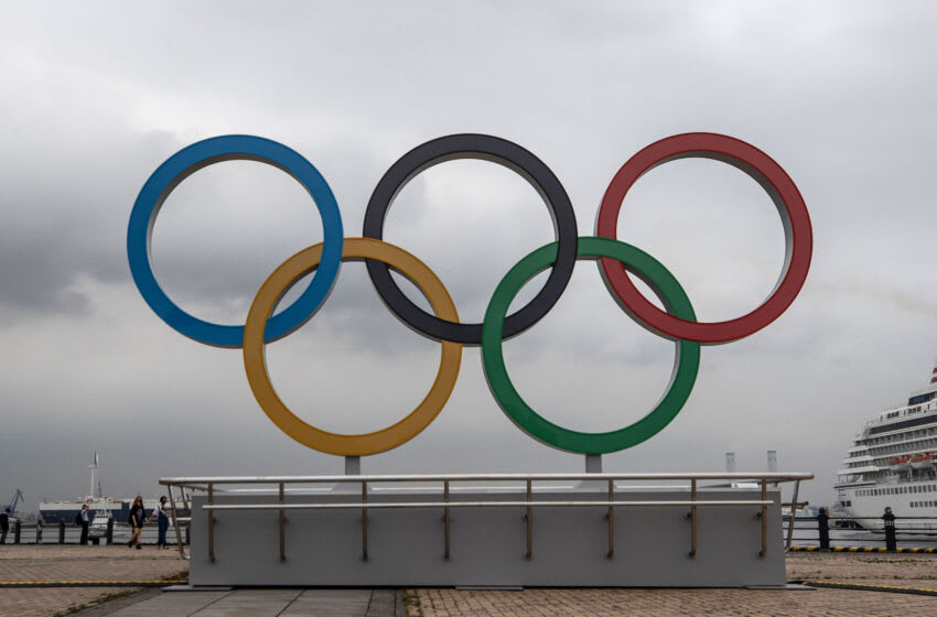 YOKOHAMA, JAPAN - JUNE 30: The Olympic Rings are displayed at Akarenga Park on June 30, 2021 in Yokohama, Japan. With less than one month to go before the start of the Tokyo Olympic Games, final preparations are being made to venues despite ongoing concern over the viability of holding the event during the global coronavirus pandemic. (Photo by Takashi Aoyama/Getty Images)