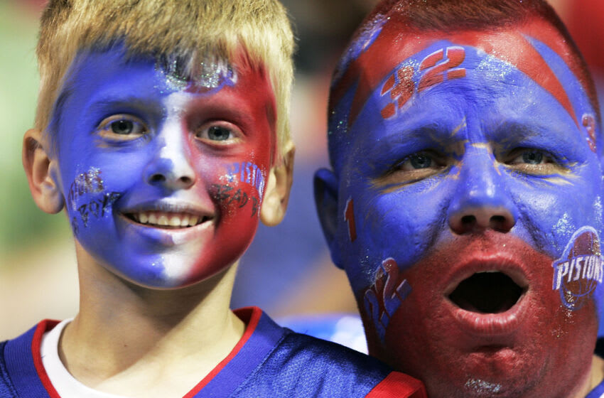 AUBURN HILLS, MI - JUNE 19: Two Piston's fans shows their support as the San Antonio Spurs take on the Detroit Pistons in Game five of the 2005 NBA Finals at The Palace of Auburn Hills on June 19, 2005 in Auburn Hills, Michigan. NOTE TO USER: User expressly acknowledges and agrees that, by downloading and or using this photograph, User is consenting to the terms and conditions of the Getty Images License Agreement. (Photo by Brian Bahr/Getty Images)