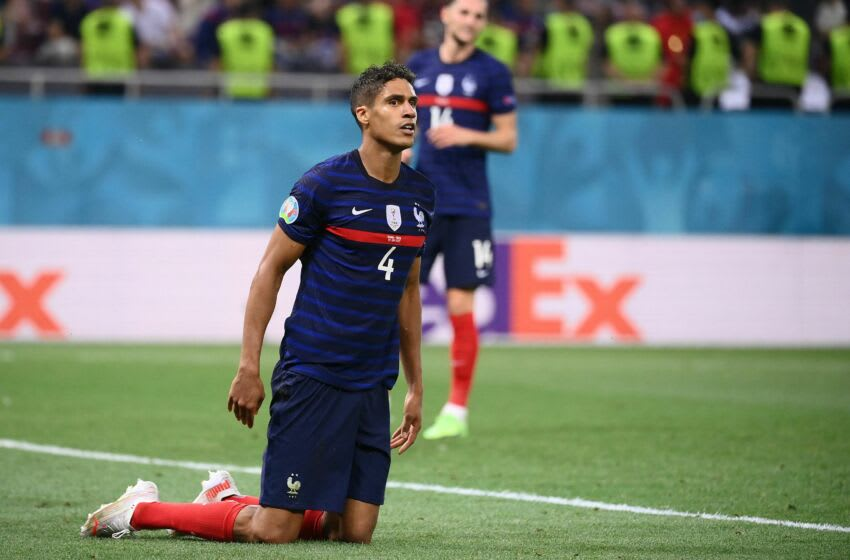 France's defender Raphael Varane gets back on his feet during the UEFA EURO 2020 round of 16 football match between France and Switzerland at the National Arena in Bucharest on June 28, 2021. (Photo by FRANCK FIFE / POOL / AFP) (Photo by FRANCK FIFE/POOL/AFP via Getty Images)