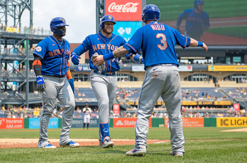 PITTSBURGH, PA - JULY 18: Travis Blankenhorn #73 of the New York Mets celebrates with Tomas Nido #3 and Jonathan Villar #1 after hitting a three run home run for his first career home run in the fourth inning during the game against the Pittsburgh Pirates at PNC Park on July 18, 2021 in Pittsburgh, Pennsylvania. (Photo by Justin Berl/Getty Images)