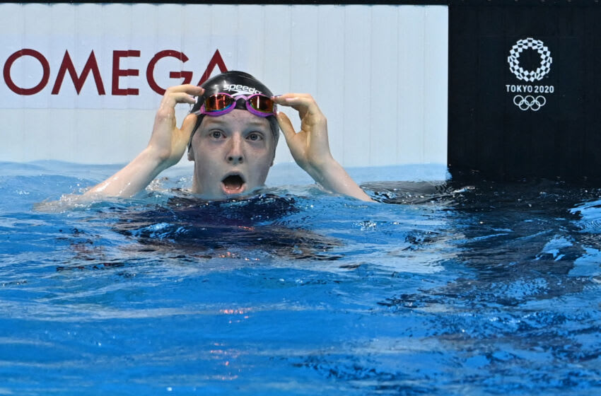 Lydia Jacoby of the United States (left) celebrates her victory in the women's 100m breaststroke final at the Tokyo 2020 Olympic Games at the Tokyo Aquatic Center in Tokyo on July 27, 2021. (Photo by Jonathan NACKSTRAND / AFP) (Photo by JONATHAN NACKSTRAND / AFP via Getty Images)
