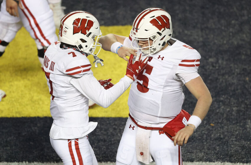 Danny Davis of the Wisconsin Badgers celebrates his second half touchdown with Graham Mertz (Photo by Gregory Shamus/Getty Images)