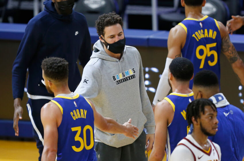 SAN FRANCISCO, CALIFORNIA - FEBRUARY 15: Klay Thompson #11 of the Golden State Warriors greets teammates during a time out in the third quarter against the Cleveland Cavaliers at Chase Center on February 15, 2021 in San Francisco, California. NOTE TO USER: User expressly acknowledges and agrees that, by downloading and/or using this photograph, user is consenting to the terms and conditions of the Getty Images License Agreement. (Photo by Lachlan Cunningham/Getty Images)
