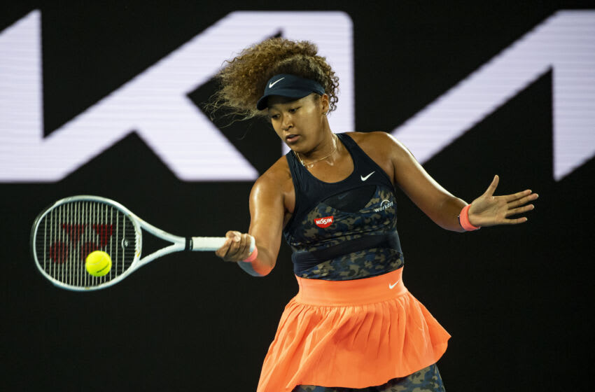 MELBOURNE, AUSTRALIA - FEBRUARY 20: Naomi Osaka of Japan hits a forehand against Jennifer Brady of the United States in the women's singles final, during day 13 of the 2021 Australian Open at Melbourne Park on February 20, 2021 in Melbourne, Australia. (Photo by TPN/Getty Images)