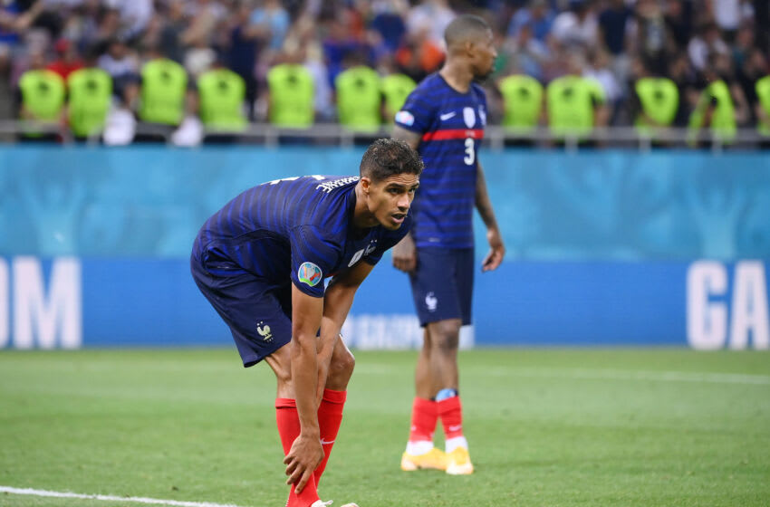 BUCHAREST, ROMANIA - JUNE 28: Raphael Varane of France reacts during the UEFA Euro 2020 Championship Round of 16 match between France and Switzerland at National Arena on June 28, 2021 in Bucharest, Romania. (Photo by Daniel Mihailescu - Pool/Getty Images)