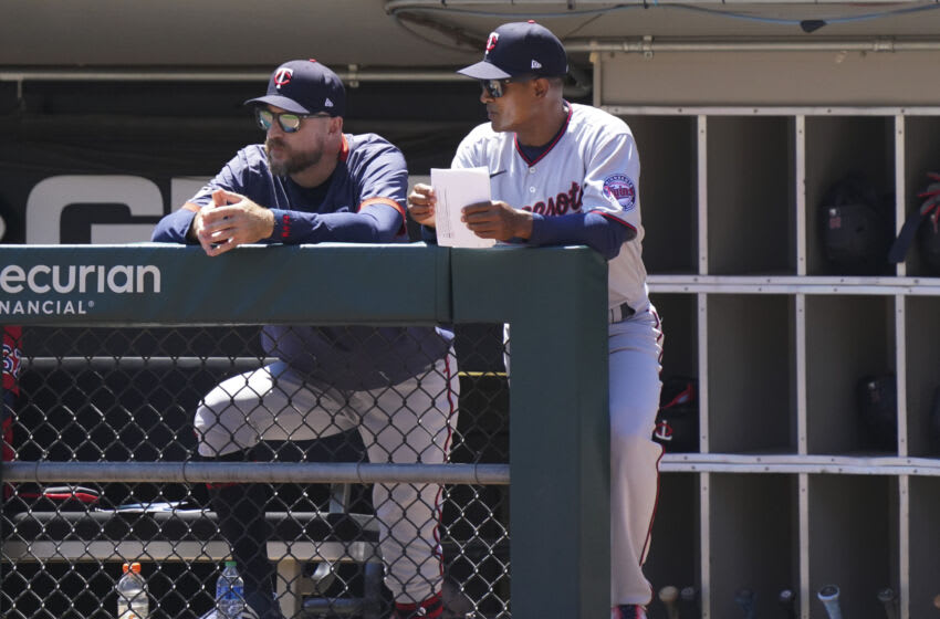 CHICAGO, ILLINOIS - JULY 01: Manager Rocco Baldelli #5 of the Minnesota Twins and third base coach Tony Diaz #46 stand in the dugout during a game against the Chicago White Sox at Guaranteed Rate Field on July 01, 2021 in Chicago, Illinois. (Photo by Nuccio DiNuzzo/Getty Images)
