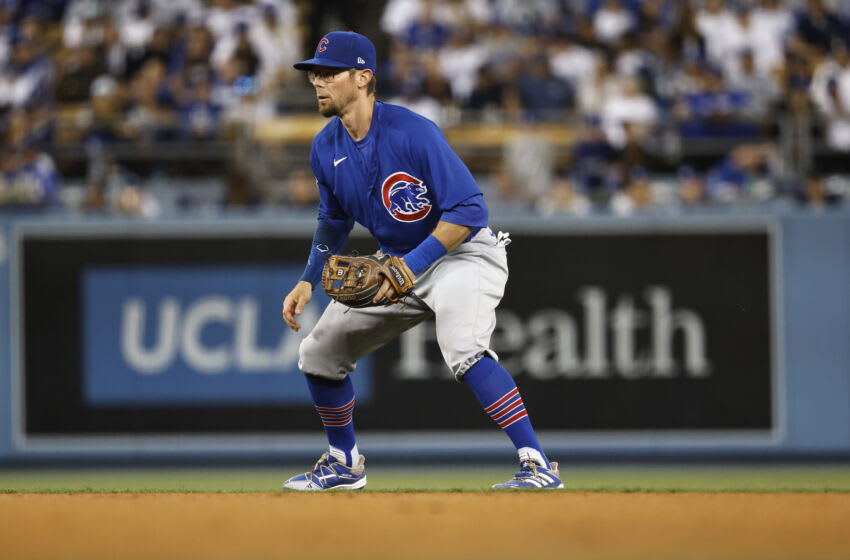 LOS ANGELES, CALIFORNIA - JUNE 24: Eric Sogard #4 of the Chicago Cubs defends against the Los Angeles Dodgers during the fifth inning at Dodger Stadium on June 24, 2021 in Los Angeles, California. (Photo by Michael Owens/Getty Images)