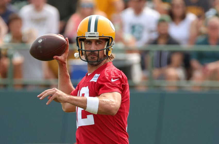 ASHWAUBENON, WISCONSIN - JULY 28: Aaron Rodgers # 12 of the Green Bay Packers coaches during training camp at Ray Nitschke Field on July 28, 2021 in Ashwaubenon, Wisconsin.  (Photo by Stacy Revere / Getty Images)