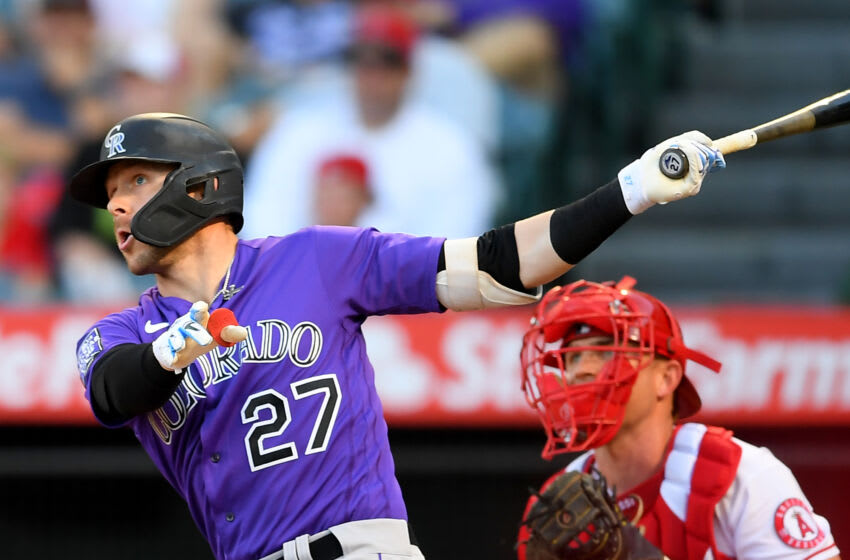 ANAHEIM, CA - JULY 28: Trevor Story #27 of the Colorado Rockies as he hits a two run home run in the first inning of the game against the Los Angeles Angels at Angel Stadium of Anaheim on July 28, 2021 in Anaheim, California. (Photo by Jayne Kamin-Oncea/Getty Images)