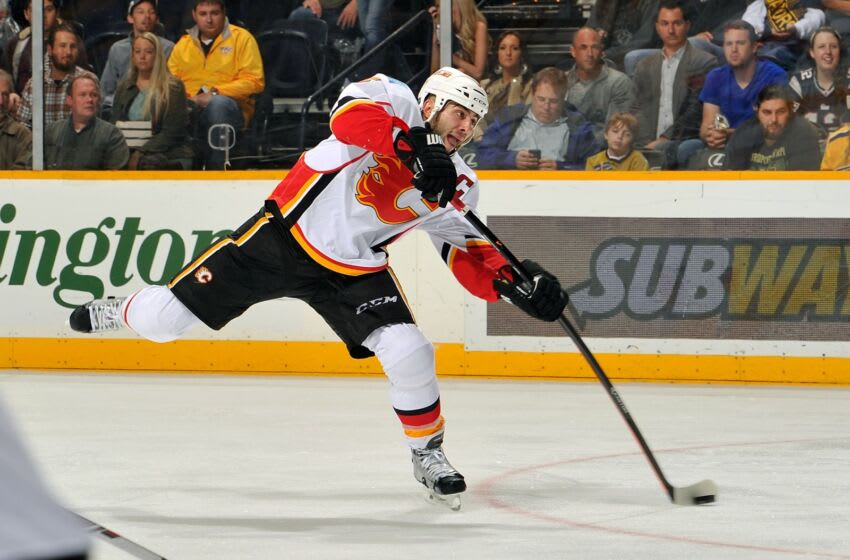 NASHVILLE, TN - OCTOBER 14: Mark Giordano #5 of the Calgary Flames takes a shot and scores a goal against the Nashville Predators at Bridgestone Arena on October 14, 2014 in Nashville, Tennessee. (Photo by Frederick Breedon/Getty Images)