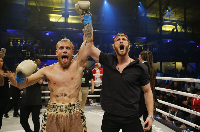 MIAMI, FLORIDA - JANUARY 30: Jake Paul celebrates with his brother, Logan, after defeating AnEsonGib in a first round knockout during their fight at Meridian at Island Gardens on January 30, 2020 in Miami, Florida. (Photo by Michael Reaves/Getty Images)