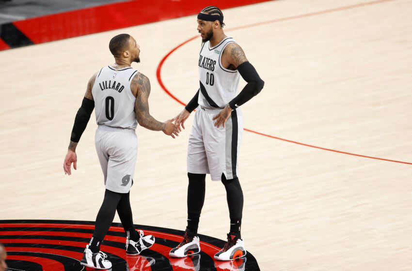 Damian Lillard and Carmelo Anthony talk during the third quarter against the Los Angeles Lakers. (Photo by Steph Chambers/Getty Images)