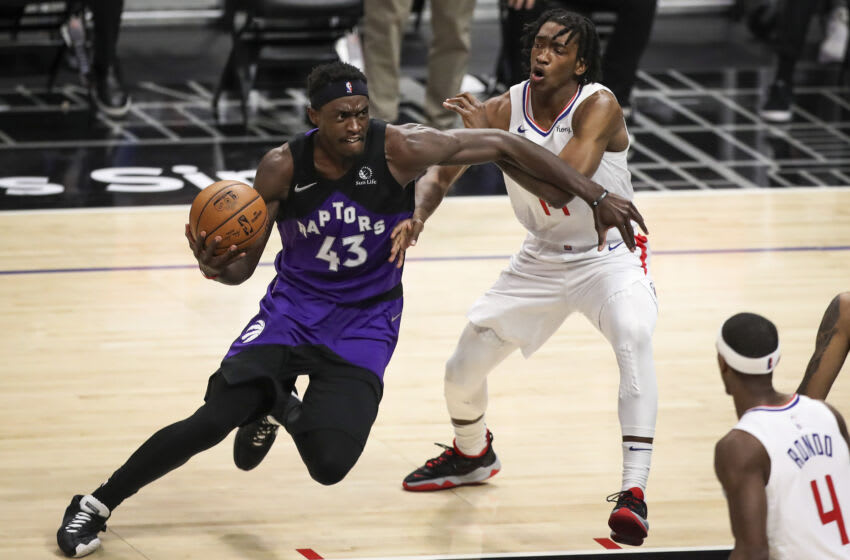 Pascal Siakam of the Toronto Raptors handles the ball defended by Terance Mann of the LA Clippers. (Photo by Meg Oliphant/Getty Images)