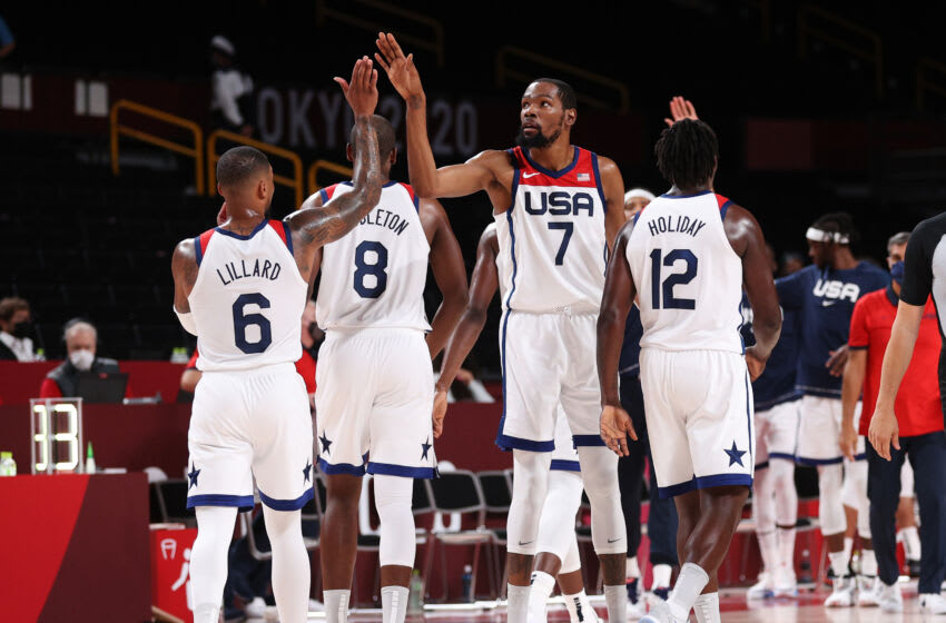 SAITAMA, JAPAN - JULY 31: Kevin Durant #7 of Team United States high-fives teammates Damian Lillard #6 of Team United States during the second half of a Men's Basketball Preliminary Round Group A game on day eight of the Tokyo 2020 Olympic Games at Saitama Super Arena on July 31, 2021 in Saitama, Japan. (Photo by Ezra Shaw/Getty Images)