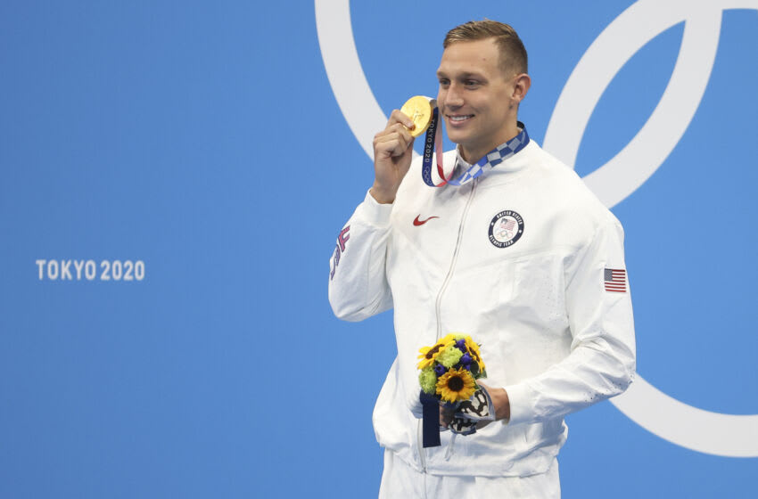 TOKYO, JAPAN - AUGUST 1: Gold Medalist Caeleb Dressel of USA during the medal ceremony of the Men's 50m Freestyle Final on day nine of the swimming competition of the Tokyo 2020 Olympic Games at Tokyo Aquatics Centre on August 1, 2021 in Tokyo, Japan. (Photo by Jean Catuffe/Getty Images)