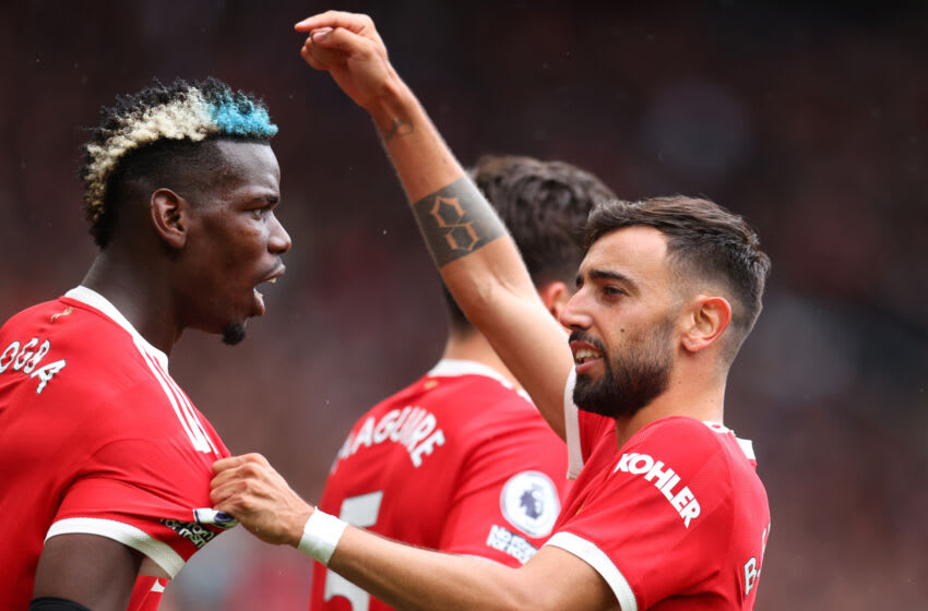 MANCHESTER, ENGLAND - AUGUST 14: Bruno Fernandes of Manchester United points to Paul Pogba during the Premier League match between Manchester United and Leeds United at Old Trafford on August 14, 2021 in Manchester, England. (Photo by Catherine Ivill/Getty Images,)