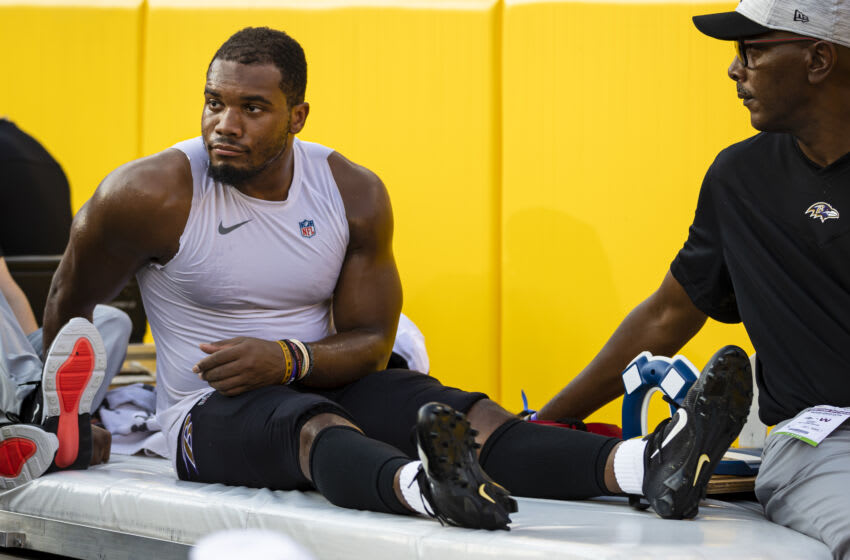LANDOVER, MD - AUGUST 28: JK Dobbins # 27 of the Baltimore Ravens run off the sidelines after being injured against the Washington Football Team in the first half of a preseason match at FedExField on August 28, 2021 in Landover, Maryland.  JK Dobbins would be injured on the piece.  (Photo by Scott Taetsch / Getty Images)