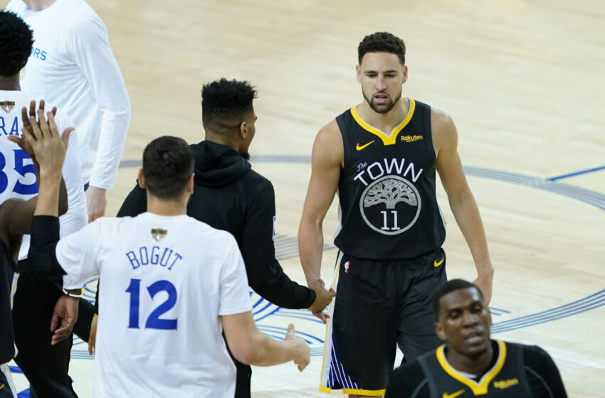 OAKLAND, CALIFORNIA - JUNE 13: Klay Thompson #11 of the Golden State Warriors reacts against the Toronto Raptors in the second half during Game Six of the 2019 NBA Finals at ORACLE Arena on June 13, 2019 in Oakland, California. NOTE TO USER: User expressly acknowledges and agrees that, by downloading and or using this photograph, User is consenting to the terms and conditions of the Getty Images License Agreement. (Photo by Thearon W. Henderson/Getty Images)