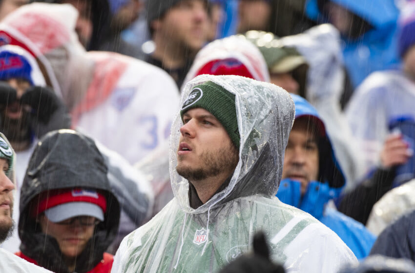 ORCHARD PARK, NY - DECEMBER 29: A New York Jets fan watches game action in the heavy rain during the second quarter against the Buffalo Bills New Era Field on December 29, 2019 in Orchard Park, New York. New York defeats Buffalo 13-6. (Photo by Brett Carlsen/Getty Images)