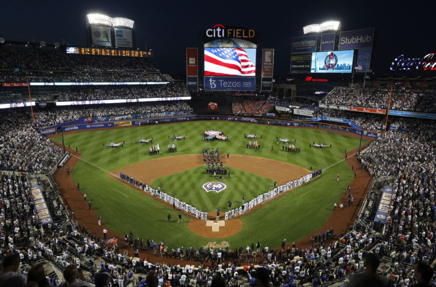 NEW YORK, NEW YORK - SEPTEMBER 11: A general view of the national anthem during ceremonies honoring the 20th anniversary of the 9/11 terrorist attacks prior to a game between between the New York Mets and the New York Yankees at Citi Field on September 11, 2021 in New York City. (Photo by Jim McIsaac/Getty Images)