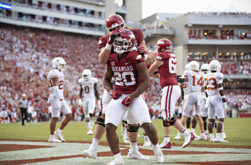 FAYETTEVILLE, ARKANSAS - SEPTEMBER 11: Dominique Johnson #20 of the Arkansas Razorbacks celebrates after scoring a touchdown in the first half of a game against the Texas Longhorns at Donald W. Reynolds Razorback Stadium on September 11, 2021 in Fayetteville, Arkansas. (Photo by Wesley Hitt/Getty Images)