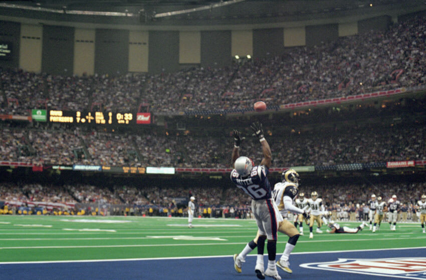 New England Patriots wide receiver David Patten catches an 8 yard touchdown pass from Tom Brady in the second quarter of Super Bowl XXXVI against the St. Louis Rams on 02/03/2002. Patten's touchdown gave the Patriots a 14 to 3 lead. They went on to win 20 to 17. (Photo by Allen Kee/Getty Images)