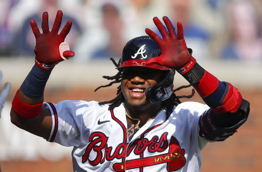 ATLANTA, GA - SEPTEMBER 04: Ronald Acuna Jr. #13 of the Atlanta Braves reacts after hitting a solo home run in the first inning of game one of an MLB doubleheader against the Washington Nationals at Truist Park on September 4, 2020 in Atlanta, Georgia. (Photo by Todd Kirkland/Getty Images)