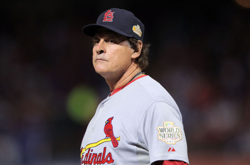ARLINGTON, TX - OCTOBER 22: Manager Tony La Russa walks onto the field in the seventh inning during Game Three of the MLB World Series against the Texas Rangers at Rangers Ballpark in Arlington on October 22, 2011 in Arlington, Texas. (Photo by Doug Pensinger/Getty Images)