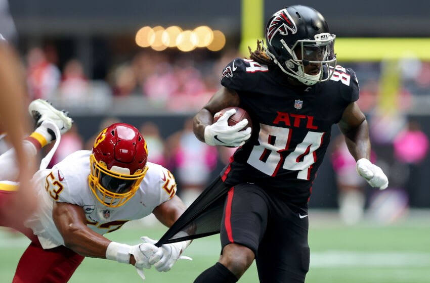 ATLANTA, GEORGIA - OCTOBER 03: Cordarrelle Patterson #84 of the Atlanta Falcons runs with the ball as Jon Bostic #53 of the Washington Football Team tries to bring Patterson down in the third quarter at Mercedes-Benz Stadium on October 03, 2021 in Atlanta, Georgia. (Photo by Kevin C. Cox/Getty Images)
