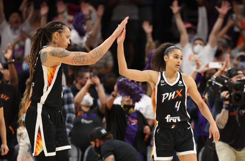 PHOENIX, ARIZONA - OCTOBER 13: Brittney Griner #42 and Skylar Diggins-Smith #4 of the Phoenix Mercury celebrate after defeating the Chicago Sky in Game Two of the 2021 WNBA Finals at Footprint Center on October 13, 2021 in Phoenix, Arizona. The Mercury defeated the Sky 91-86 in overtime. NOTE TO USER: User expressly acknowledges and agrees that, by downloading and or using this photograph, User is consenting to the terms and conditions of the Getty Images License Agreement. (Photo by Christian Petersen/Getty Images)