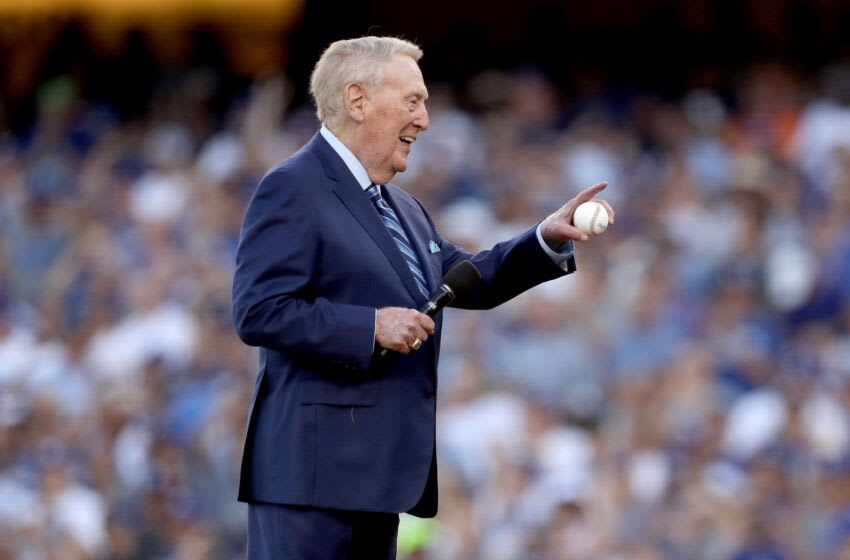 LOS ANGELES, CA - OCTOBER 25: Former Los Angeles Dodgers broadcaster Vin Scully addresses fans before game two of the 2017 World Series between the Houston Astros and the Los Angeles Dodgers at Dodger Stadium on October 25, 2017 in Los Angeles, California. (Photo by Christian Petersen/Getty Images)