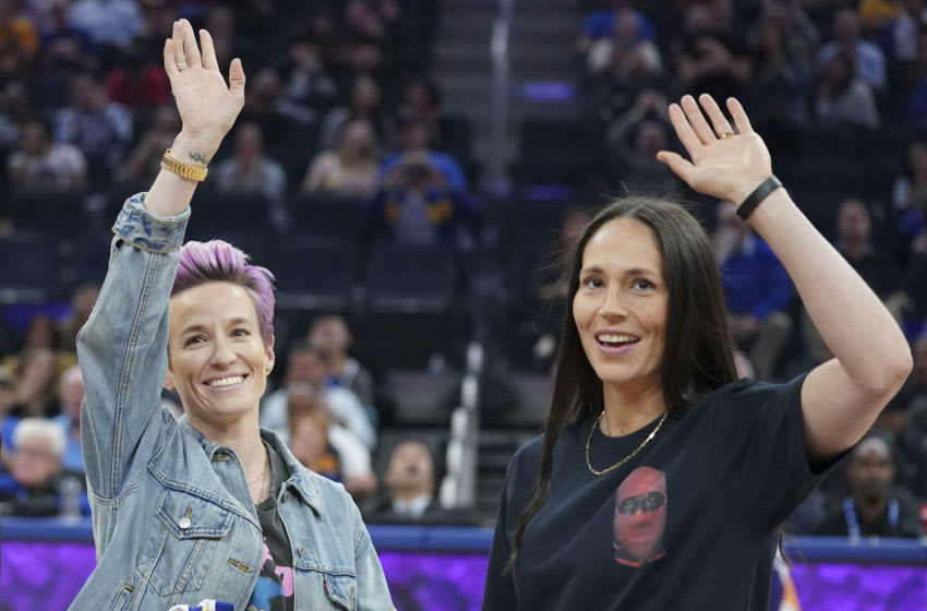 October 30, 2019; San Francisco, CA, USA; Megan Rapinoe (left) and Sue Bird (right) wave during the second quarter between the Golden State Warriors and the Phoenix Suns at Chase Center. Mandatory Credit: Kyle Terada-USA TODAY Sports