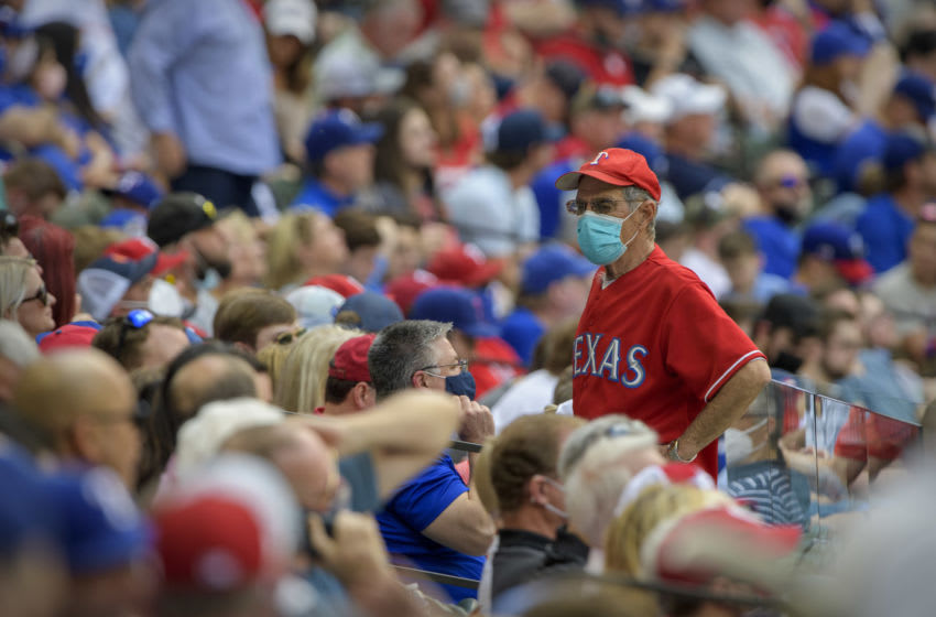 Apr 5, 2021; Arlington, Texas, USA; A view of a fan wearing a mask during the fifth inning of the game between the Texas Rangers and the Toronto Blue Jays at Globe Life Field. Mandatory Credit: Jerome Miron-USA TODAY Sports