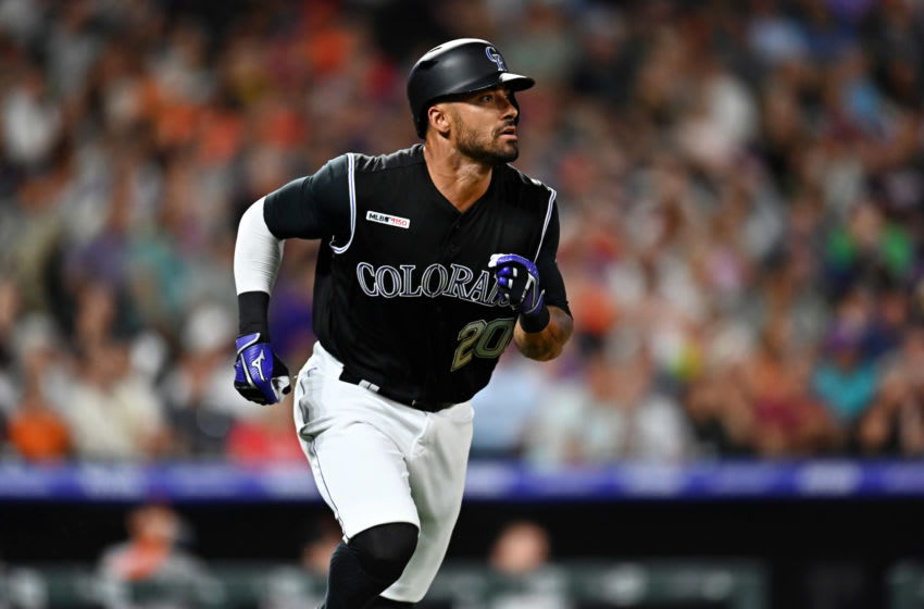 Aug 2, 2019; Denver, CO, USA; Colorado Rockies center fielder Ian Desmond (20) runs out his RBI double in the seventh inning against the San Francisco Giants at Coors Field. Mandatory Credit: Ron Chenoy-USA TODAY Sports